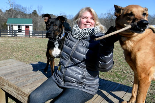 Cindy Fashing plays with her two dogs, Jordan and Jax, at her neighborhood dog park in Carothers Farms in Nolensville on Tuesday, Jan. 29, 2019.