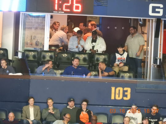Collier Engineering officials, along with Metro employees including Don Reid, paving manager of Metro Public Works, in a Bridgestone Arena suite in March 2018. The city has placed Reid on administrative leave pending the outcome of an investigation into Collier's billing practices.