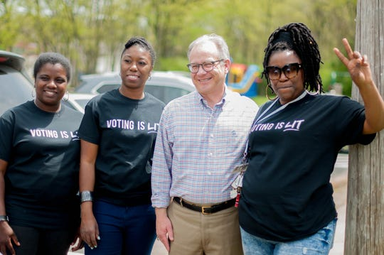 Charlane Oliver, center, poses with then interim Mayor David Briley on April 21, 2018, at an Equity Alliance voter registration block party at Hartman Park. Also pictured are Equity Alliance co-founders Kyonzte Toombs, left, and Tequila Johnson, right.