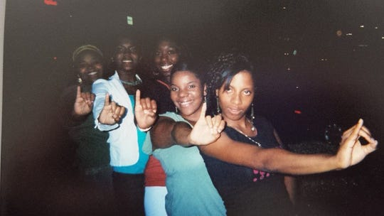 Charlane Oliver, center, poses with her Vanderbilt University sorority line sisters in spring 2005 in front of the West End Chili's restaurant. From left are Monica Johnson, Atia Jordan Harris, Oliver, Kimyatta McClary and Audrey Austrie-Holmes.