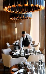 Waiter Geoff Sebold prepares for the night's guests inside Bourbon Steak on the top floor of the JW Marriott which opened in 2018 to a booming hotel market in Nashville