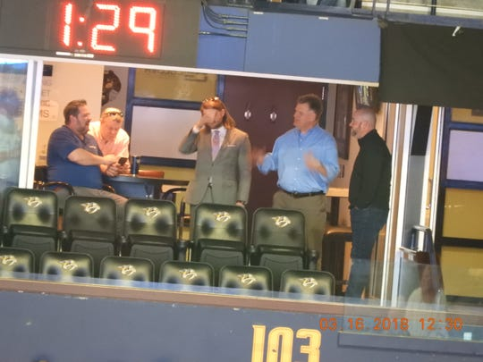 Collier Engineering officials and others in a Bridgestone Arena suite in March 2018.