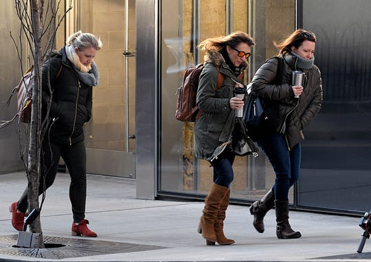 People walk in 24 degree weather in downtown Nashville on Tuesday,  Jan. 29, 2019.