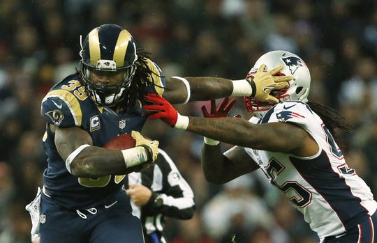 St. Louis Rams running back Steven Jackson, left, tries to get past New England Patriots linebacker Brandon Spikes on Sunday in London. AP St. Louis Rams running back Steven Jackson, left, is caught by New England Patriots middle linebacker Brandon Spikes, during the first half of a NFL football game at Wembley Stadium, London, Sunday, Oct. 28, 2012. (AP Photo/Matt Dunham)