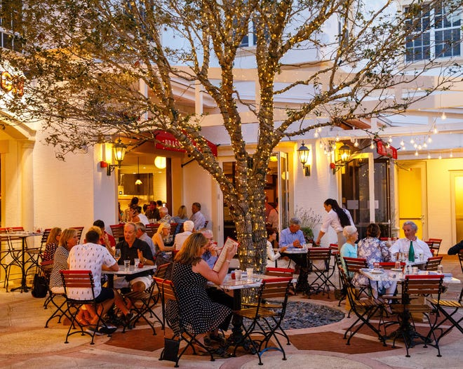 Patrons dine al fresco on the patio at The French in downtown Naples.
