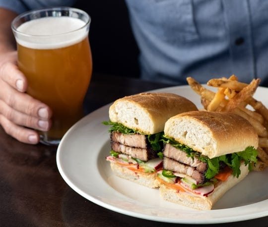 Yard House's new menu items include Pork Belly Banh Mi with pickled vegetables, cilantro, serranos and sriracha aïoli.