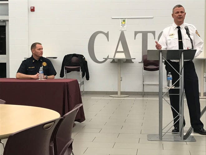 Newark Fire Chief Pat Connor listens as Newark Police Chief Barry Connell discusses school safety Monday, during a forum in the Newark High School Commons.