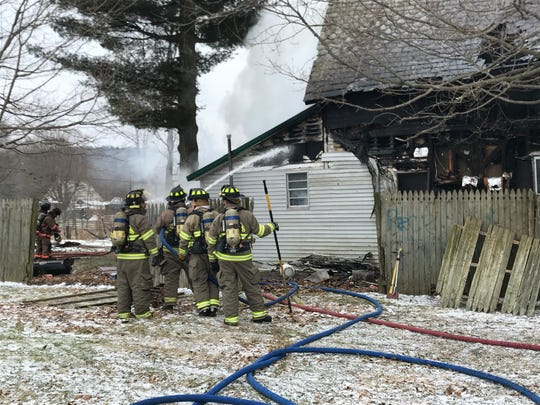 Crews battle a house fire in Newton Township Tuesday, Jan. 29, 2019.
