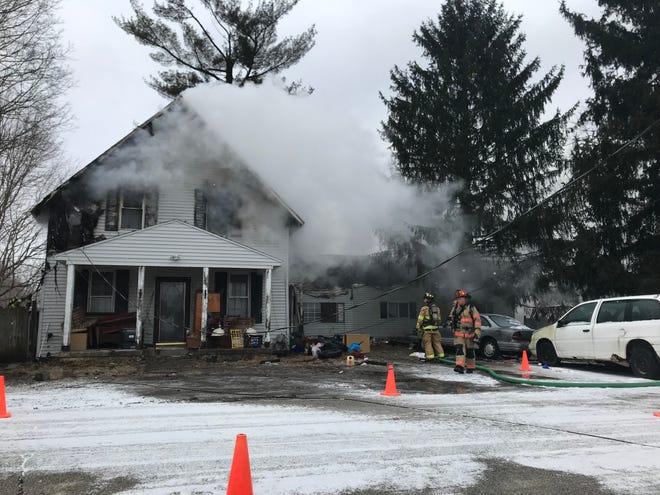 Crews battle a house fire in Newton Township Tuesday, Jan. 29, 2019.
