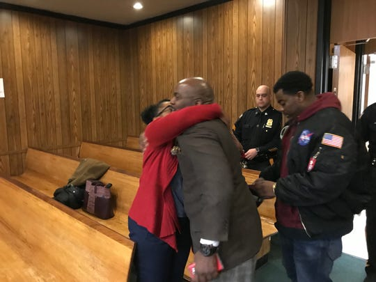 Derrick Chestnut gets a hug from his wife as he leaves the courtroom.