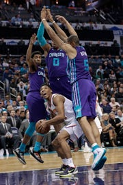 New York Knicks' Allonzo Trier (14) is trapped by Charlotte Hornets' Nicolas Batum (5), Miles Bridges (0), and Malik Monk (1) during the second half of an NBA basketball game in Charlotte, N.C., Monday, Jan. 28, 2019. (AP Photo/Chuck Burton)