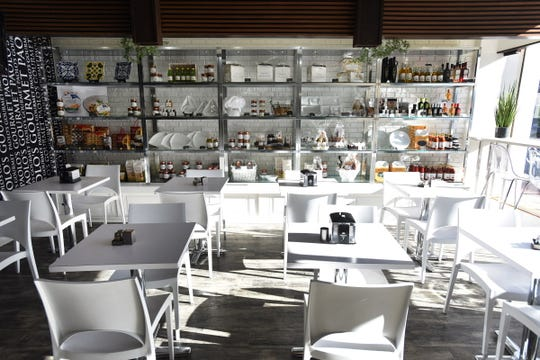 The sunlit modern dining room of Paolo's Gourmet in Westwood