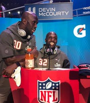 Twins Jason, left, and Devin McCourty share a laugh after the former crashed the latter's interview session during Super Bowl Opening Night at State Farm Arena in Atlanta.
