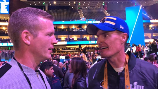Chris Simms, son of Giants legend Phil, and John Fassel, son of former Giants coach Jim, share a moment Monday at Super Bowl LIII Opening Night. John Fassel is the special teams coordinator of the Rams, who play the Patriots Sunday in Atlanta.