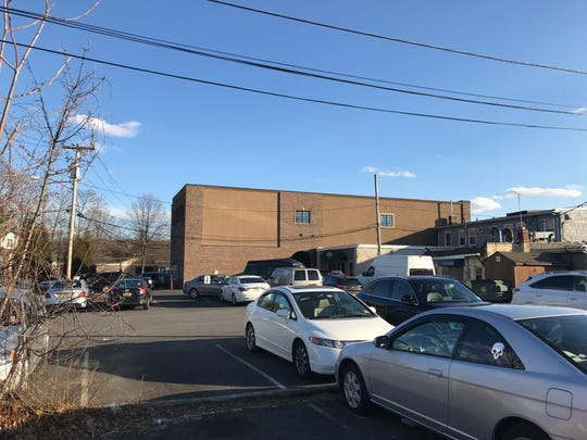 These parking spaces behind businesses located on Cresskill's Union Avenue will be incorporated into a new municipal parking lot.