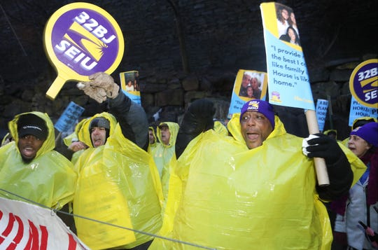 Hundreds including, Marc Anderson (right, foreground, holding sign), came out to a rally for S2BJ union workers, outside the Horizon Housing apartment complex.  The workers at the complex are on strike over a contract dispute regarding health care and pension. Tuesday, January 29, 2019