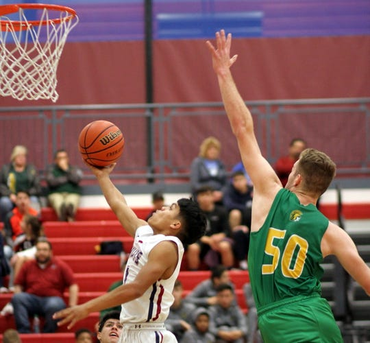 Jordan Caballero beat the interior of Mayfield's defense for two of his 10 points on Friday. A Wildcat rally from 17 points fell short in a 73-64 loss at home.