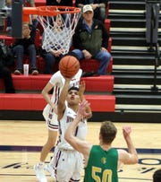 Jordan Caballero (1) attacked the basket on Friday and dropped in 10 points in a 73-64 home defeat against Mayfield High.