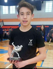 Carlos (Litos) Apodaca was voted as the tournament's most outstanding wrestler in the middleweight division.