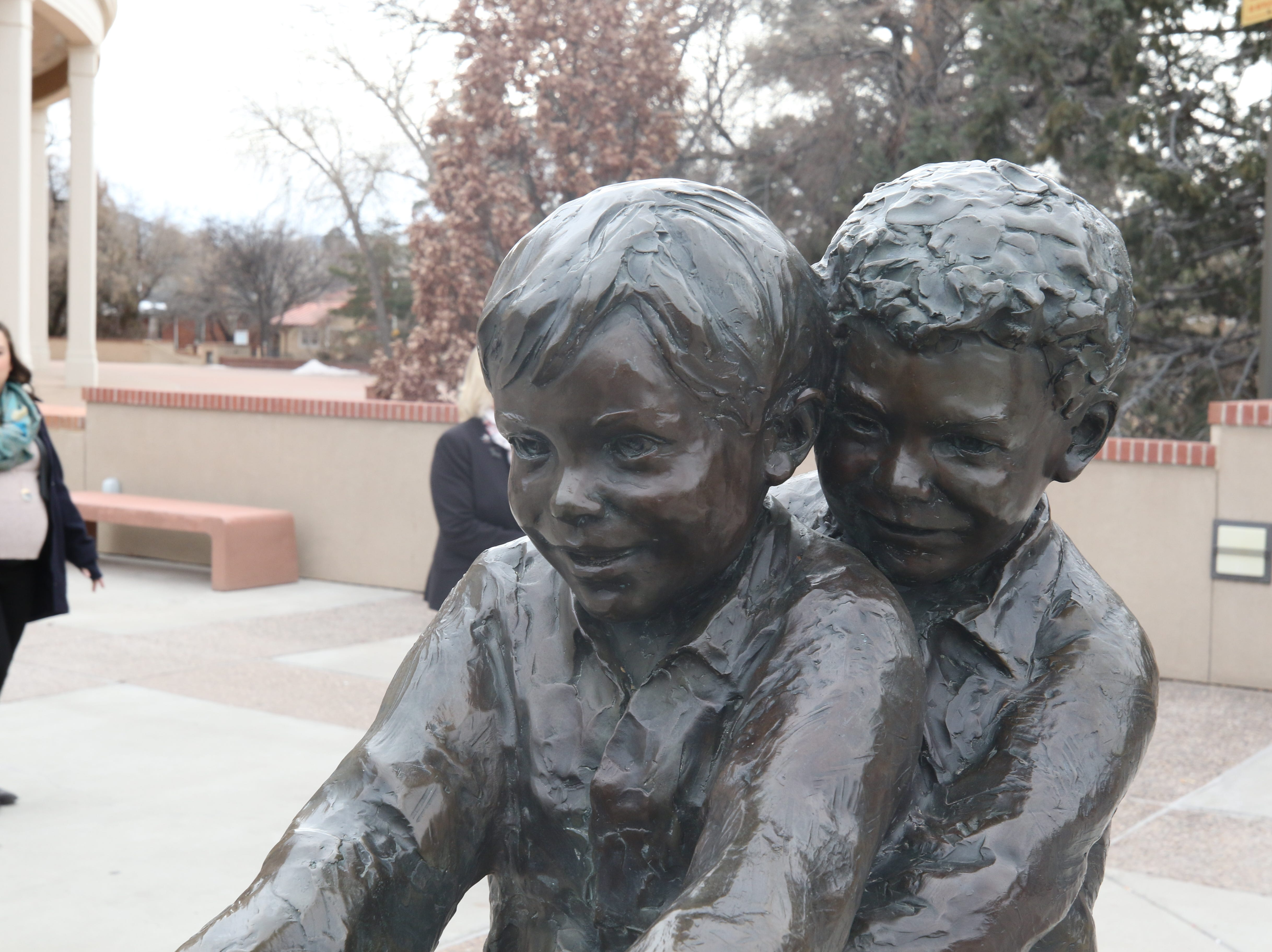 A statue of children playing outside the Roundhouse, Jan. 29, 2019 in Santa Fe.