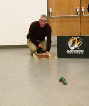 Holloman High Speed Test Track Engineering Lead John Leslie launches a car during the AHS CO2 Car Launch Competition Monday afternoon.