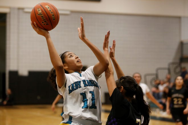 Navajo Prep's Hailey Martin puts up a shot against Kirtland Central on Jan. 15 at the Eagles Nest in Farmington. Prep moved up to seventh in this week's 3A girls rankings, while PV and Farmington moved up in this week's 5A girls rankings.