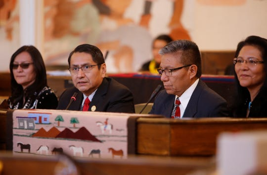 Navajo Nation President Jonathan Nez, second from left, was joined by first lady Phefelia Herbert-Nez, Vice President Myron Lizer and second lady Dottie Lizer for the State of the Nation address during the Navajo Nation Council winter session on Monday at the council chamber in Window Rock, Ariz.