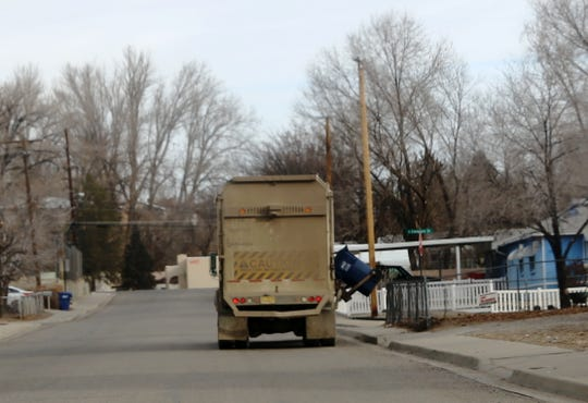 A solid waste truck moves through an an Aztec neighborhood on Tuesday.