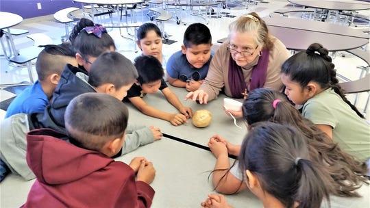 Rafaela Martinez's class inspects the jicama and passed it around.