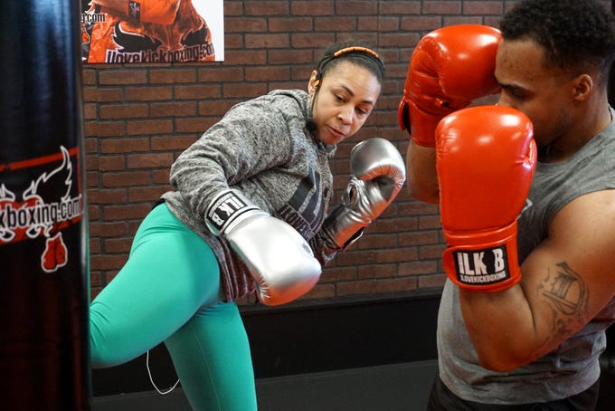 Monica Carson, general manager of Novi's recently-opened I Love Kickboxing, demonstrates a proper kick to employee Antonio Green on Jan.29. I Love Kickboxing's Novi business, its fifth in the Metro Detroit region, opened three weeks ago in West Oaks II at 43448 West Oaks Drive.