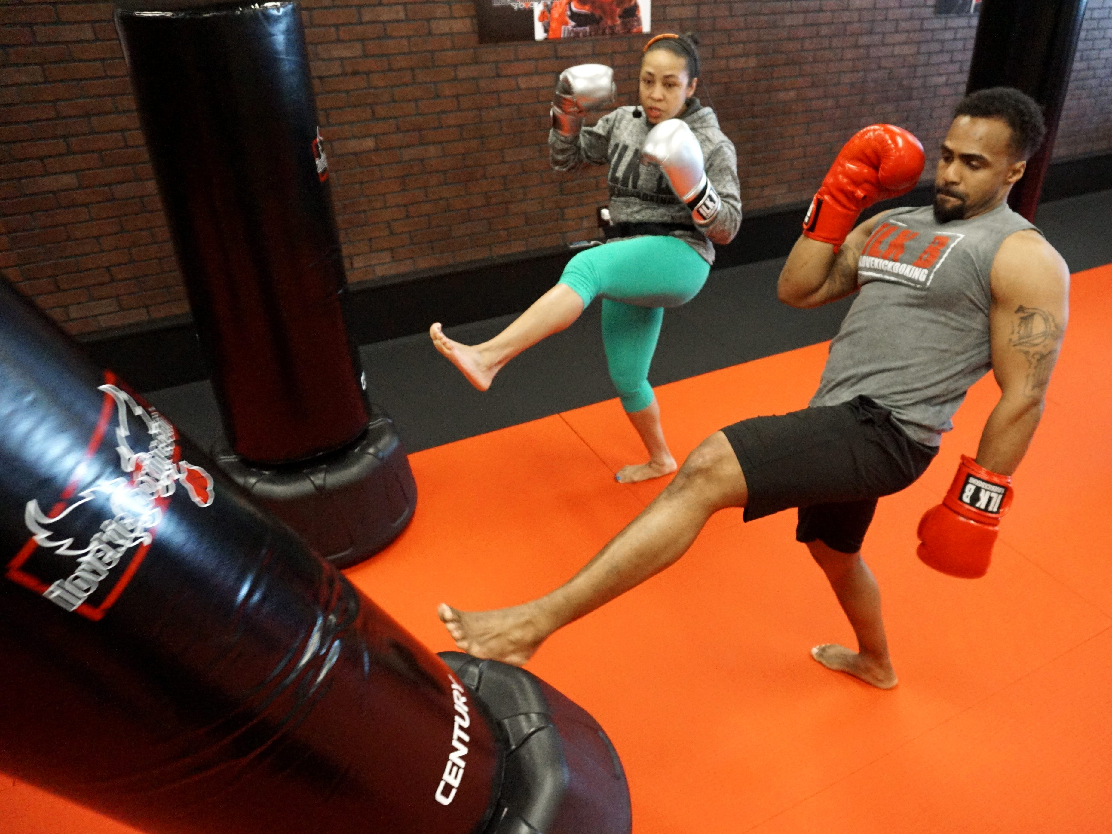 Students of I Love Kickboxing get to do lots of boxing and... kicking as Antonio Green demonstrates here.