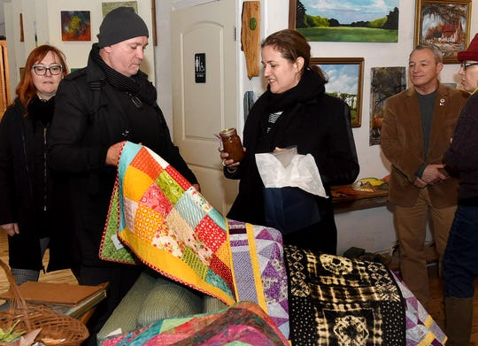 Benedicte de Montlaur is shown a homemade quilted blanket during a visit by her and other representatives of the French consulates in New Orleans and New York to the Arnaudville area on Tuesday afternoon. A meeting with local officials took place at NuNu Arts and Culture Collective just outside the town.