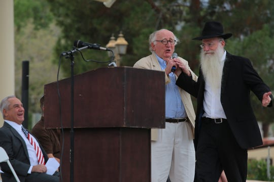 Rabbi Yonason Denebeim jokes as he grabs the microphone to speak at Palm Desert's annual Holocaust Remembrance Day, January 28, 2019.