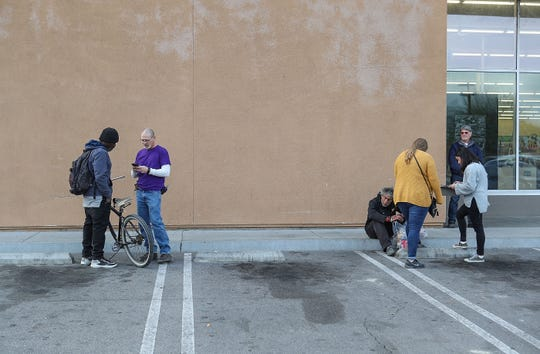 Volunteers interview homeless people in Indio during a point-in-time count of homeless people in the Coachella Valley, Jan. 19, 2019.
