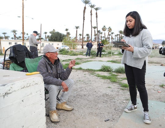 Glenn Ryan, left, who is homeless, is interviewed by volunteer Nikki Gomez, during a point-in-time count of homeless people in the Coachella Valley, Jan. 19, 2019.