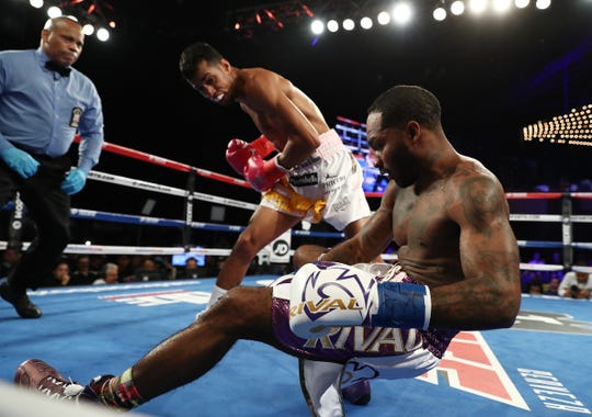 Alberto Machado knocks out  Yuandale Evans in the first round of  their title fight at Madison Square Garden on October 27, 2018 in New York City.