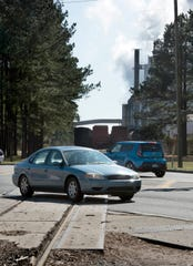 Escambia County and CSX officials met Tuesday to address the problem of trains blocking roadways, such as this one at U.S. 29 and Muscogee Road in Cantonment, for hours at a time.