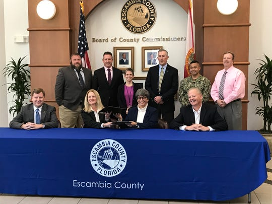 Escambia County staff and commissioners exchange deeds with personnel from Naval Facilities Engineering Command Southeast Jan. 29, 2019. The county and the U.S. Navy exchanged an operational helicopter training airfield, Naval Outlying Landing Field 8, located in Escambia County, for a new helicopter field in Santa Rosa County.