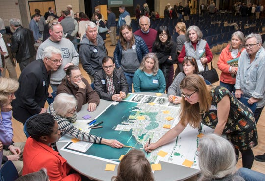 At right, Gena Wirth with SCAPE Landscape Architecture leads a group exercise Jan. 28 discussing the Pensacola waterfront ecology and hydrology during a public forum at the Sanders Beach-Corinne Jones Resource Center.