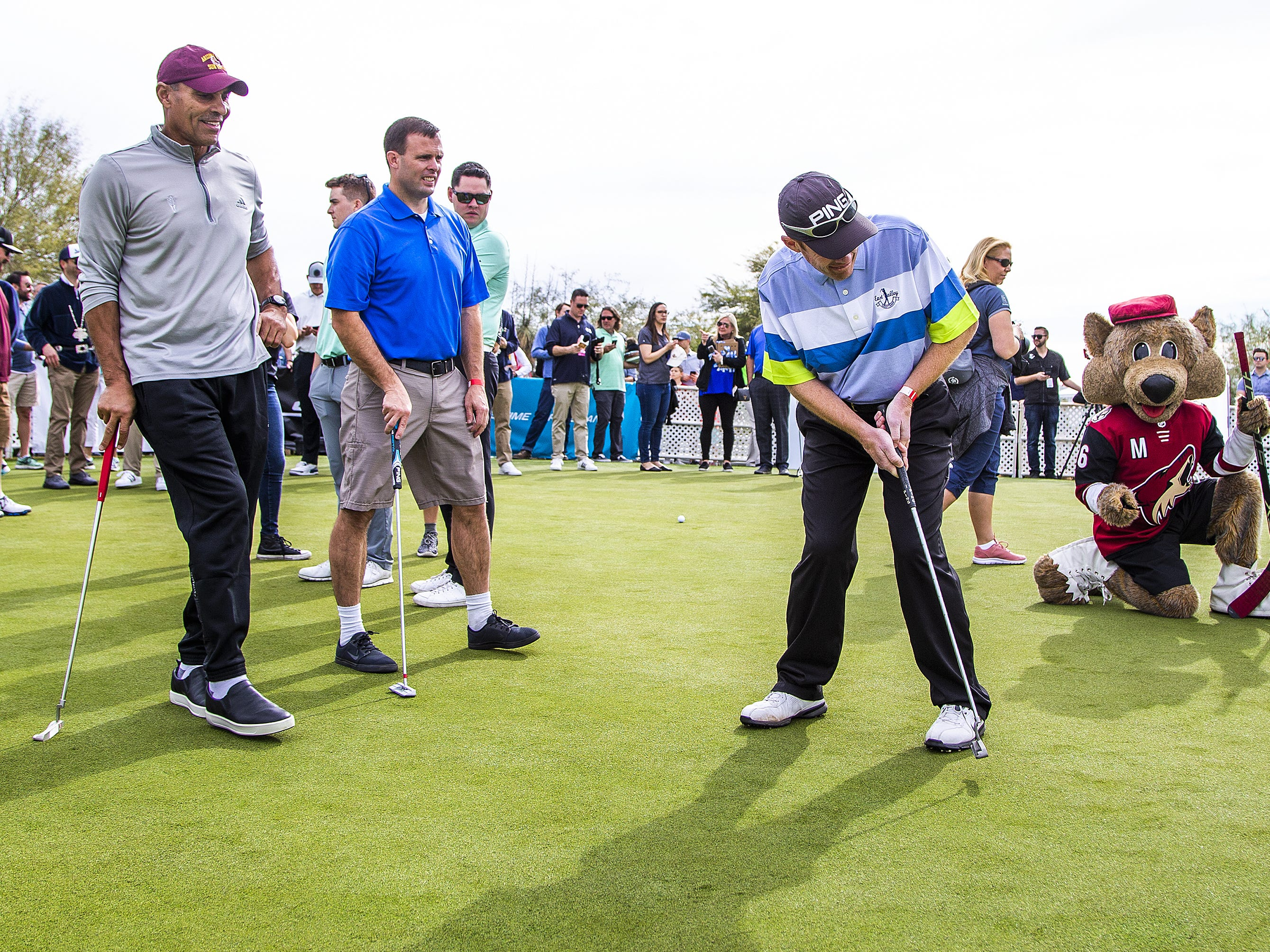Brian Jantzen, Gilbert, right, putts as his partner, ASU head coach Herm Edwards, left, watches during the San Tan Ford Special Olympics Open at the Waste Management Phoenix Open at the TPC Scottsdale, Tuesday, January 29, 2019.