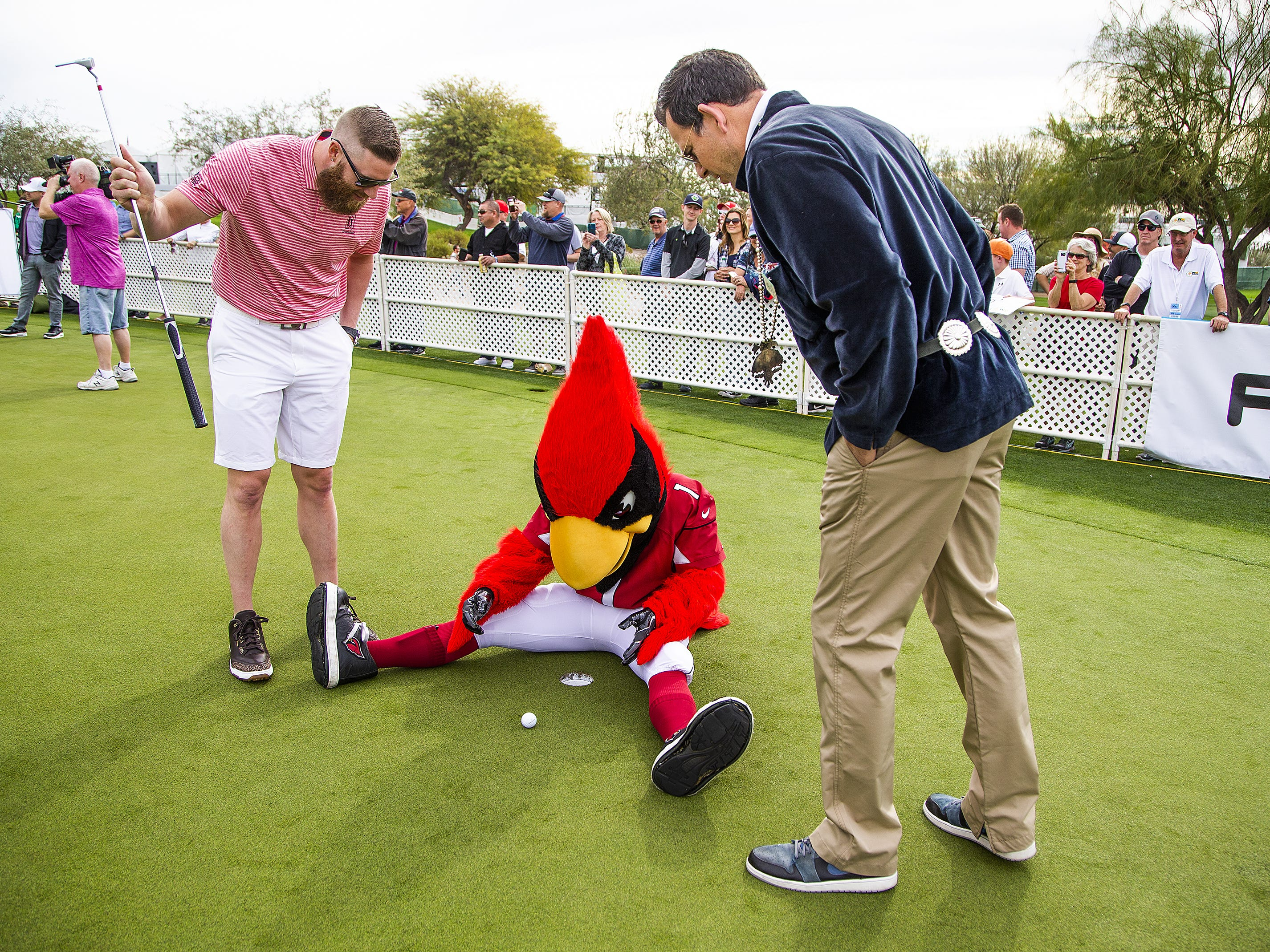 Arizona Diamondbacks pitcher Archie Bradley, left, and the Arizona Cardinals mascot, Big Red, play around during the San Tan Ford Special Olympics Open at the Waste Management Phoenix Open at the TPC Scottsdale, Tuesday, January 29, 2019.