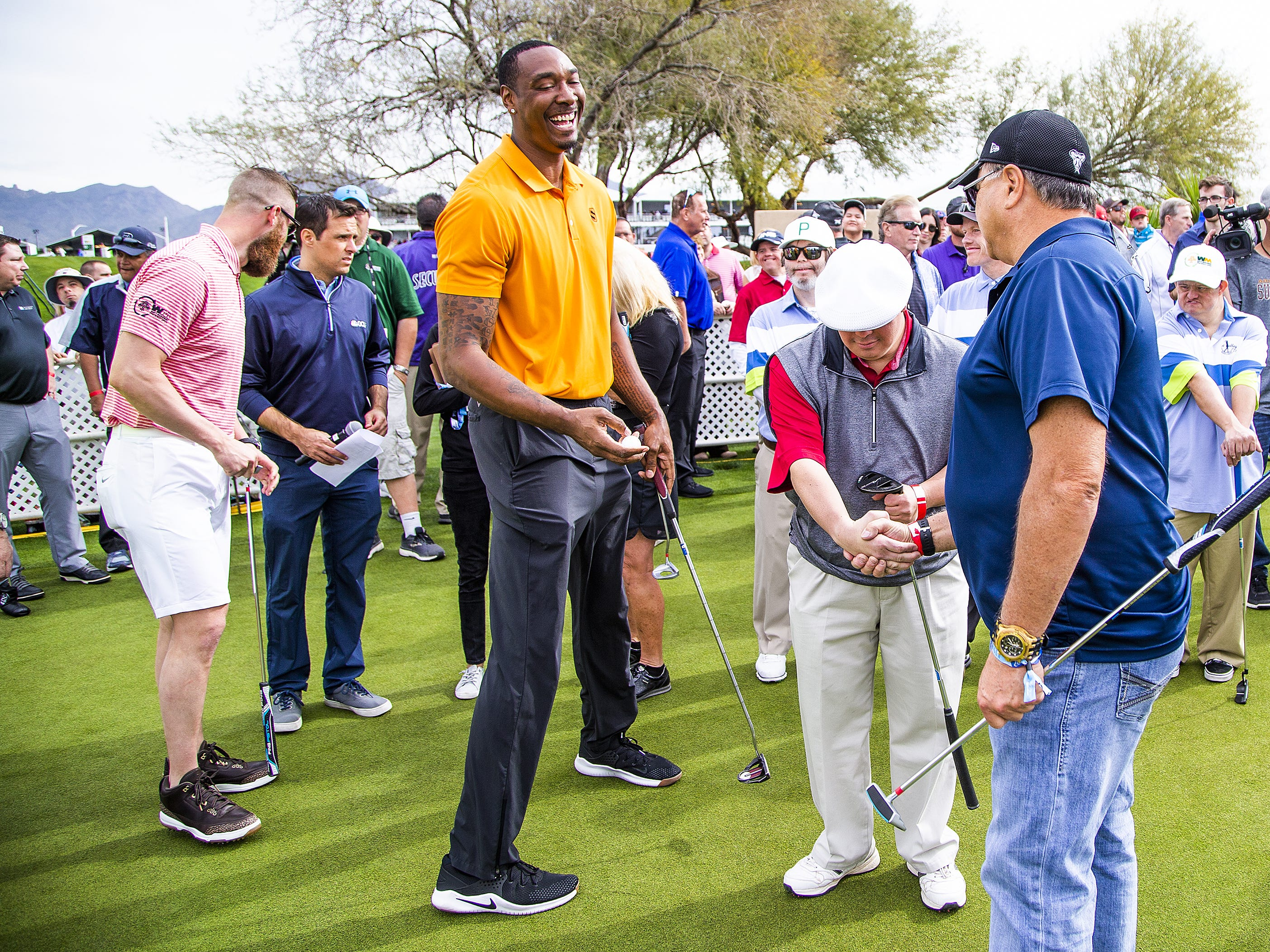 Phoenix Suns community ambassador Steven Hunter, orange shirt, smiles during the San Tan Ford Special Olympics Open at the Waste Management Phoenix Open at the TPC Scottsdale, Tuesday, January 29, 2019.