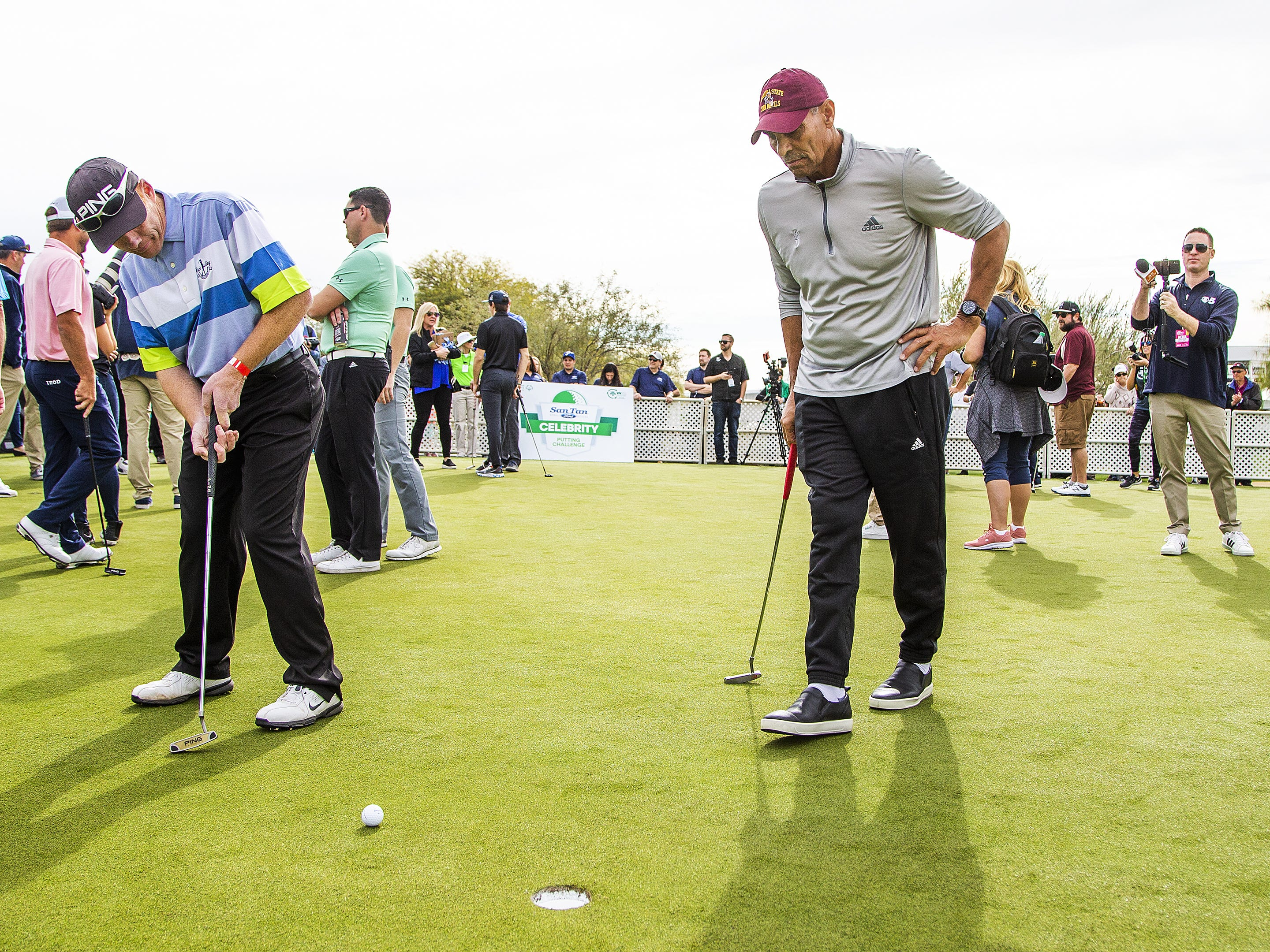 Brian Jantzen, Gilbert, left, putts as his partner, ASU head coach Herm Edwards watches during the San Tan Ford Special Olympics Open at the Waste Management Phoenix Open at the TPC Scottsdale, Tuesday, January 29, 2019.