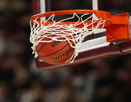 A basketball goes through the hoop during the 6A boys basketball semifinal between Desert Vista and Pinnacle at Wells Fargo Arena in Tempe, Ariz. February 21, 2018.