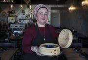 A portrait of Mazal Uvaydov with Manti from Cafe Chenar in Phoenix, Jan. 28, 2019.