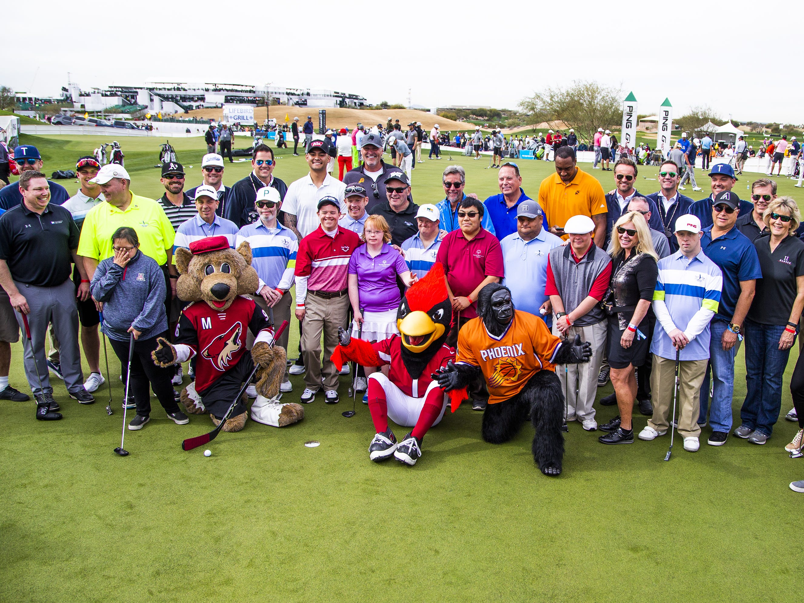 A group portrait is taken at the conclusion of the San Tan Ford Special Olympics Open at the Waste Management Phoenix Open at the TPC Scottsdale, Tuesday, January 29, 2019.