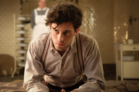 """Eugen Freide (Aaron Altaras) at a former Jewish hospital turned Gestapo detention center in """"The Invisibles."""""""