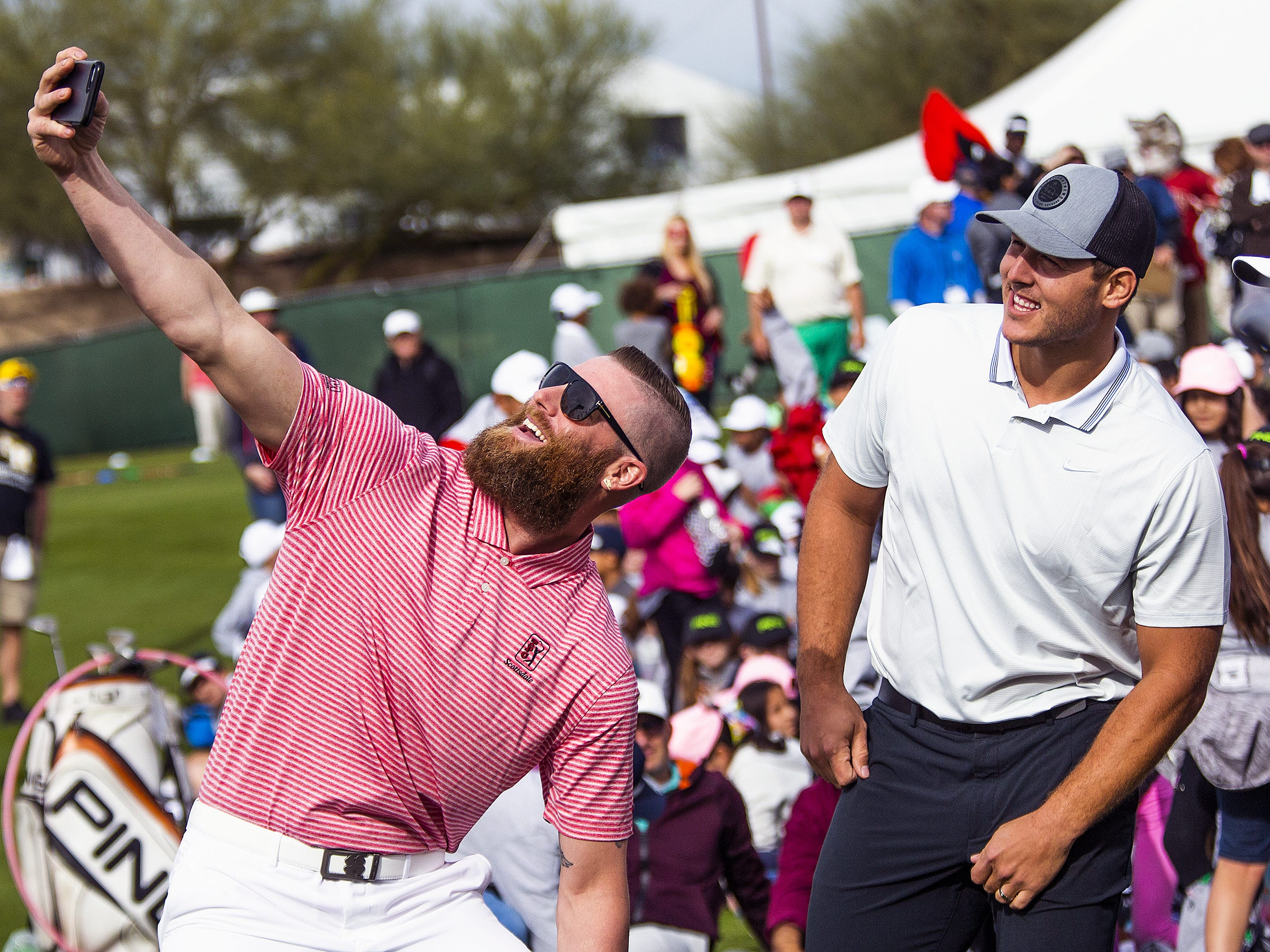 Arizona Diamondbacks pitcher Archie Bradley takes a selfie with Chicago Cubs first baseman Anthony Rizzo and a crowd of children at the conclusion of the R.S. Hoyt Jr. Family Foundation Dream Day Junior Golf Clinic presented by PING at the Waste Management Phoenix Open at the TPC Scottsdale, Tuesday, January 29, 2019.