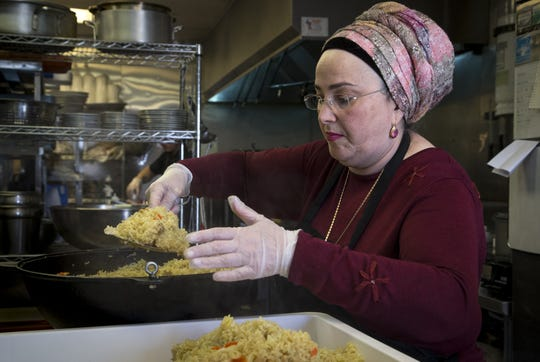 Mazal Uvaydov works in the kitchen at Cafe Chenar in Phoenix.