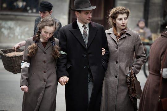 "Julia Lewenfisz-Gorka (from left), Wojciech Zielinski and Marta Ormaniec star in ""Who Will Write Our History."""